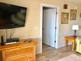 A large flat screen TV is in the living room for your enjoyment.
