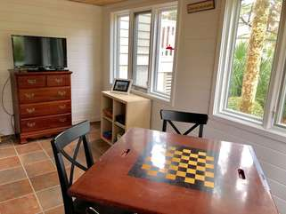 Play cards  or checkers or chess around the game table in the room off the 4th bedroom.