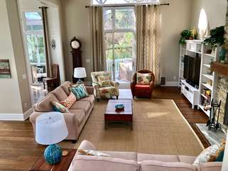 Beautiful living room with cathedral ceilings and open floor plan plus 55