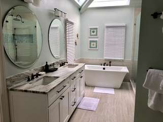 Fabulously remodeled master bathroom with free standing tub, dual sinks, granite counter tops and large shower.