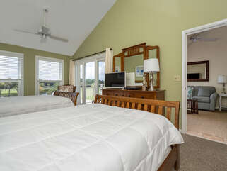 Enjoy the large master bedroom with cathedral ceilings with plenty of natural light.