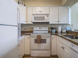 The upgraded kitchen has granite counters and new appliances and cabinetry.