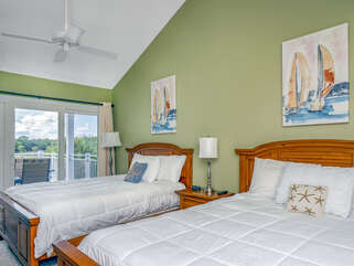 Two queen beds are in the 2nd bedroom with sliding door access to deck