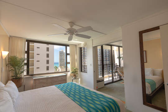 Bedroom looks out over pool and rec-deck as well as to the ocean.  Adjustable ceiling fan creates even more breezes without the A/C if you prefer