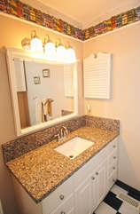 The newly renovated master en-suite bath has tiled floors and large vanity.