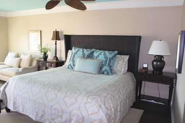 The spacious master bedroom has a king bed.