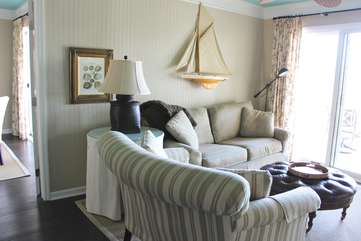 Wainscot walls and a sky blue ceiling create a warm atmosphere.