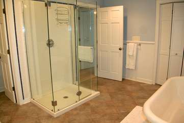 Rinse in the glass encased shower.
