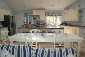 The dining area has a huge table perfect for gathering.