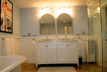 Soak in the claw foot tub in the master bathroom.