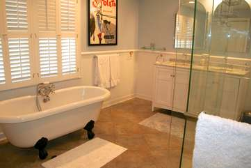 The master bathroom is very luxurious and features a claw foot soaking tub.