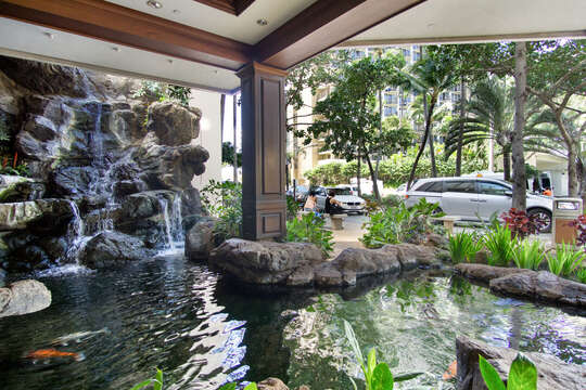 Beautiful serenity waterfall found in the entrance area of the Waikiki Banyan