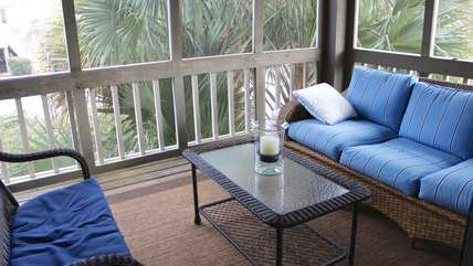 Relax with a good book or sip a cool drink on this great screened porch.