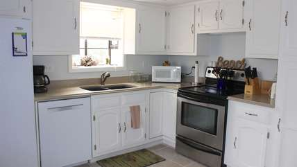 The kitchen has been uplifted and features tile flooring and well stocked cabinets.