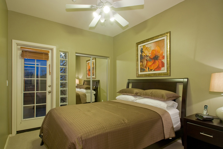 Upstairs guest bedroom with a queen bed