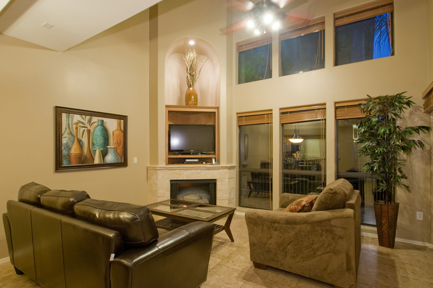 Living room is light and bright with vaulted ceiling