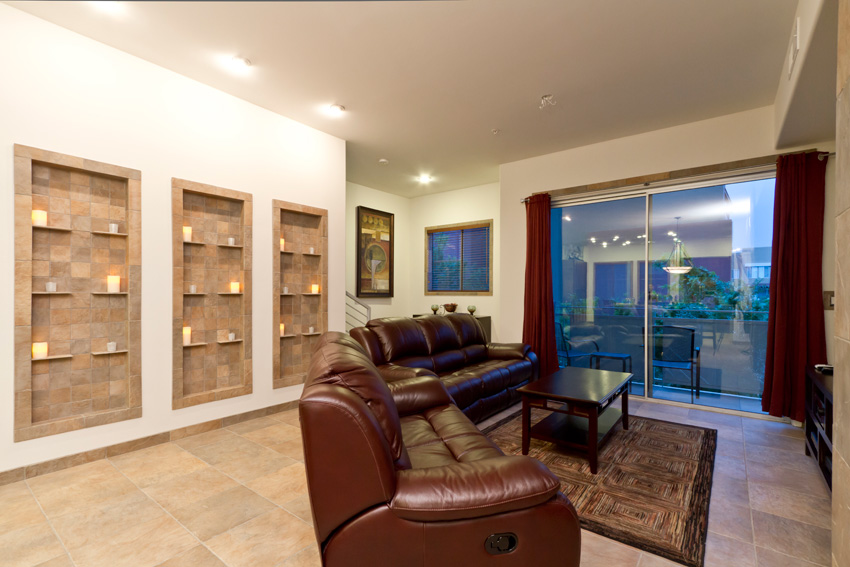 Come enjoy the ambiance of this understated living room with super comfortable leather couches.