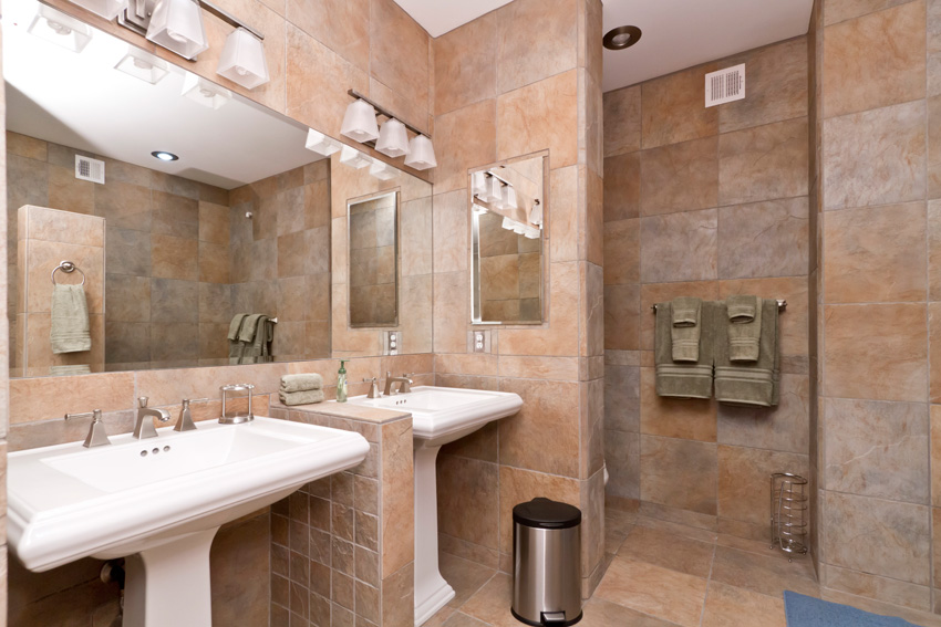 Double pedestal sinks are set up for sharing
