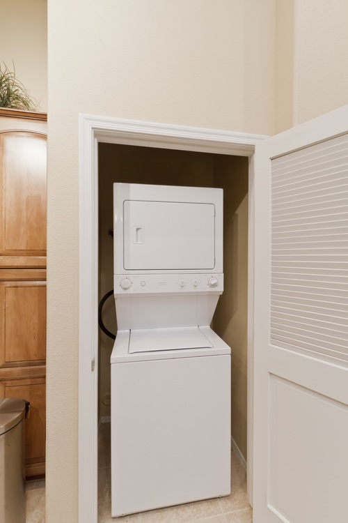 Stackable washer and dryer set in unit