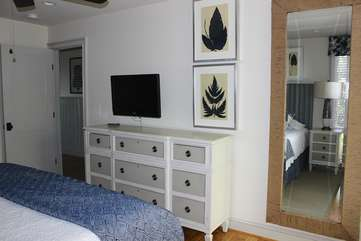 There is a large mirror and ample dresser space for your clothing.