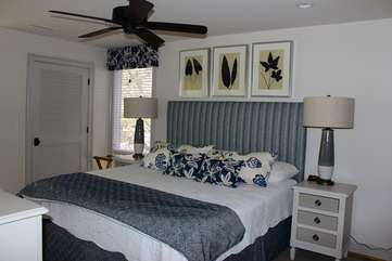 Down the hall is the master bedroom.  Soft grays & blues invite you to relax.