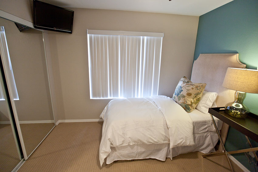 one of 2 beds in bedroom three