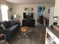 Living room with sleep sofa and flat screen TV