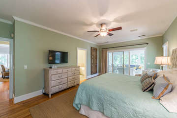 There is a mounted HDTV, walk-in closets, and en suite bath.
