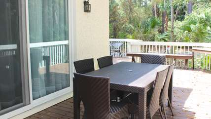 Dine around the table on the deck.