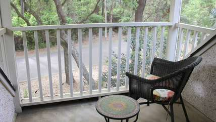 Relax on the screened balcony with your coffee.
