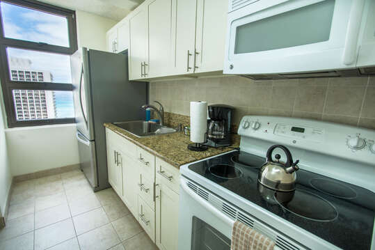 Full kitchens with stoves, full fridges, microwaves and kitchenware