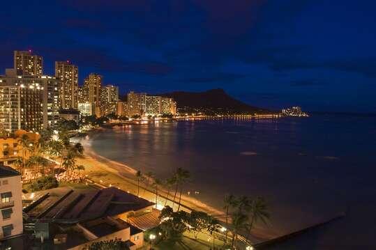View of Waikiki Beach at night looking towards Diamond Head