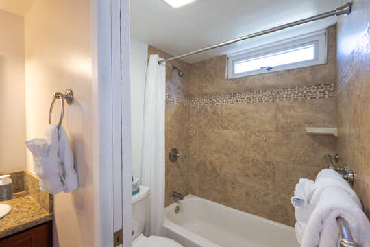 Full size shower with tub all  beautifully tiled.