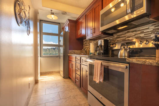 All appliances are stainless steel with full size side by side fridge, stove, microwave and granite counters.  Everything you need in kitchen wares, also rice cooker, blenders, coffee maker, toaster, etc.