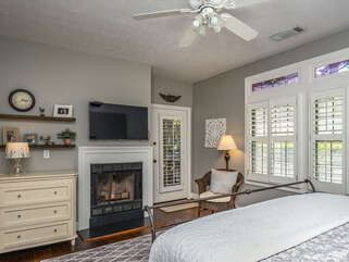 There is a fireplace and wall mounted HDTV.  Door leads to the screened in porch overlooking the 6th green of Crooked Oaks golf course.