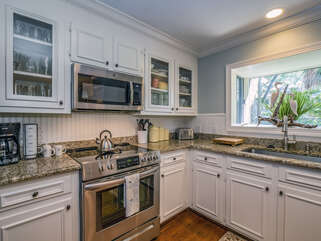 The cabinets are stocked with all the comforts of home.