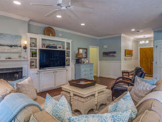 Hardwood floors, wainscot, built in bookshelves and a large HDTV  are just some of the updated features throughout