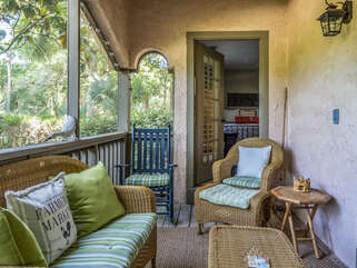 The screened porch has wicker furnishings & overlooks Crooked Oaks #5, par 3.