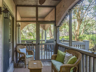 Screened porch adjacent to covered deck