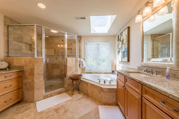 Beautiful master bath has two separate vanities, a jetted tub, and corner shower.