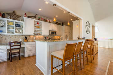 Open kitchen with upgraded Viking appliances and counter seating is on the 2nd floor.