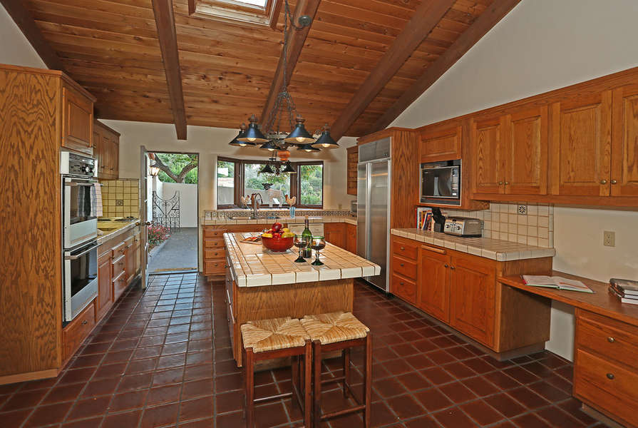 Kitchen is bright with views from bay window