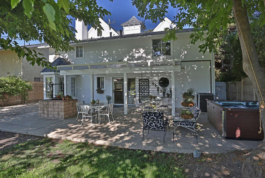 Enjoy the backyard with large lawn and shade trees