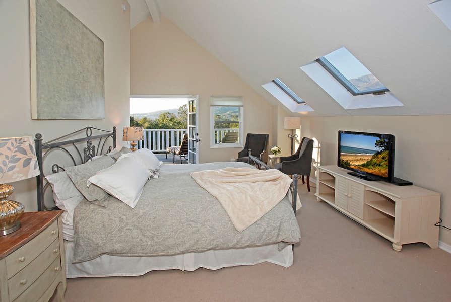 Master Bedroom on mezzanine level off Family Room