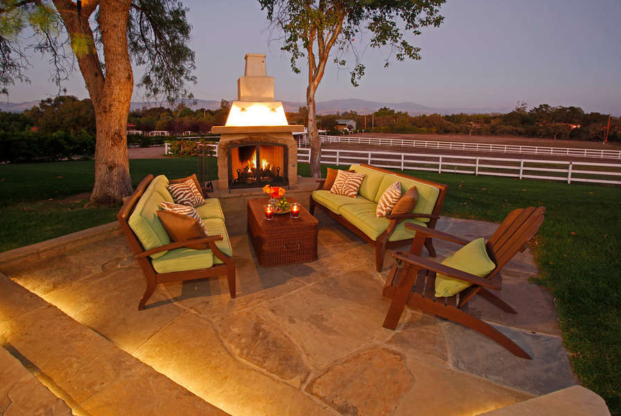 Warm up year round by the outdoor fireplace