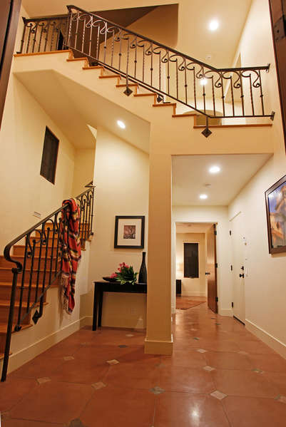 A welcoming entry leads to the 1st floor Master Suite