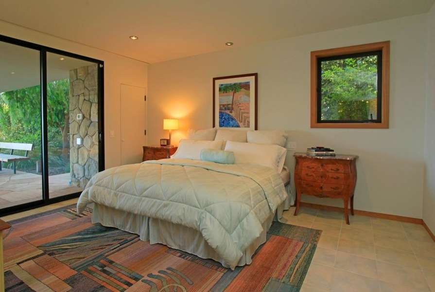 Private lower level bedroom #3 offers pool & ocean views
