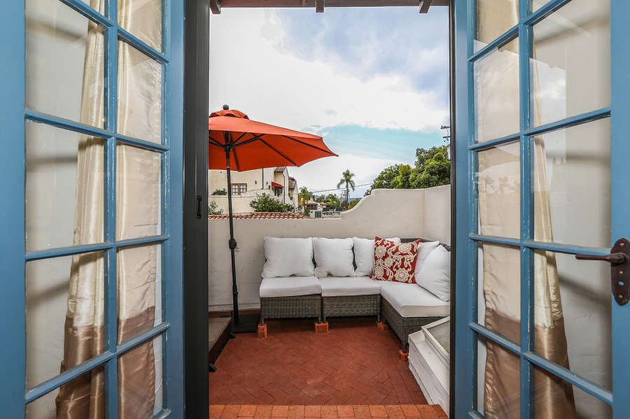 French doors lead to spa deck and city views