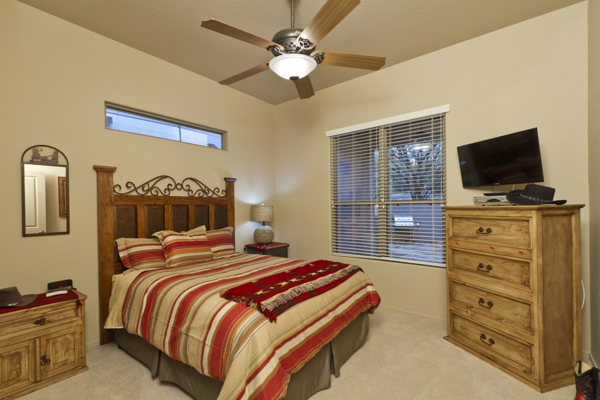 Get in the true southwestern spirit in this bedroom with a view of the back patio