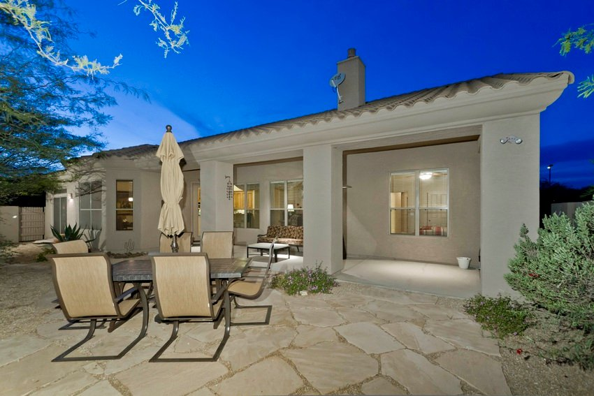 Enjoy the backyard with either dining or lounging off the covered patio